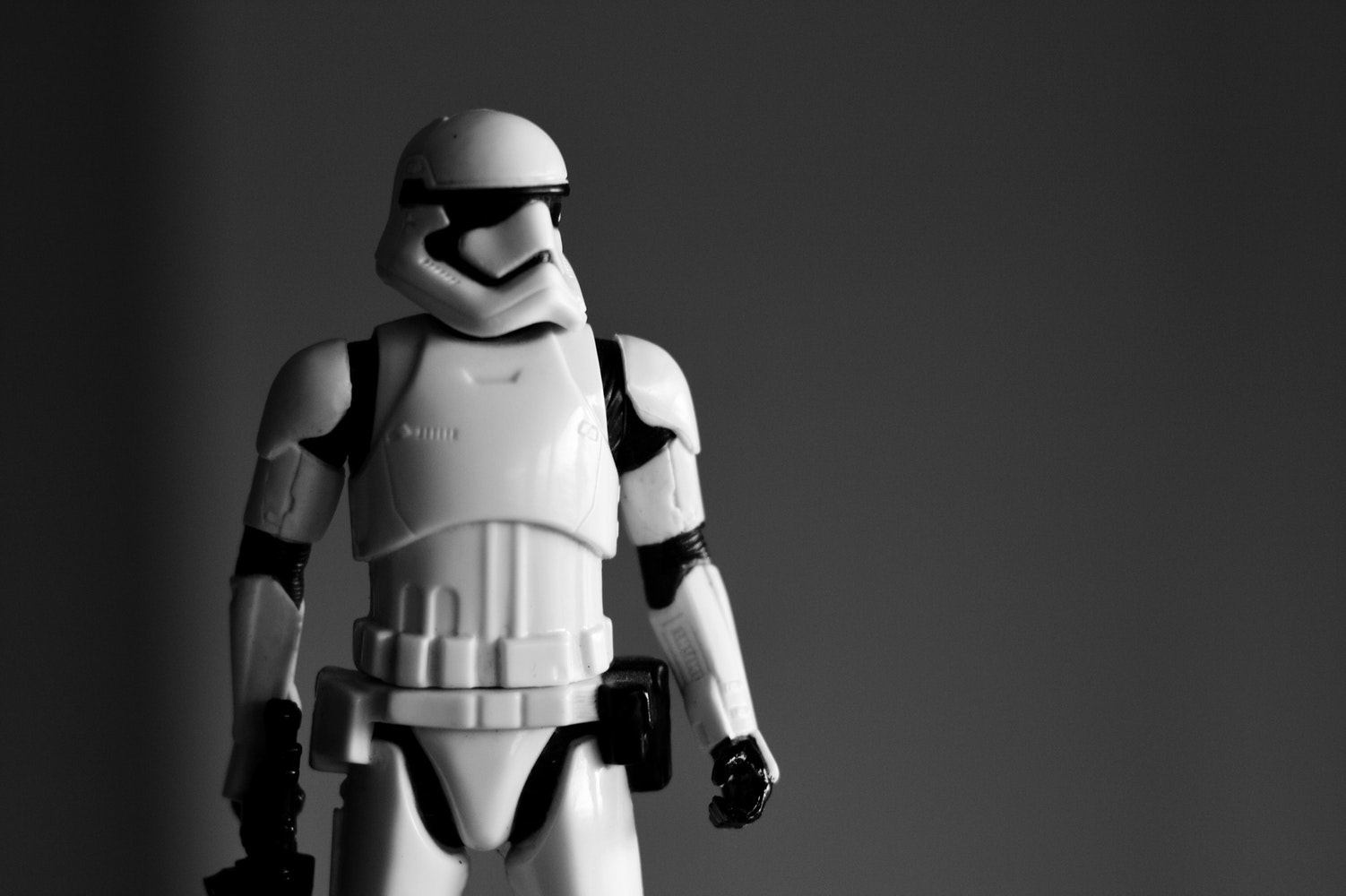 Storm trooper action figure in grey background. Storm troopers are characters from star wars universe.